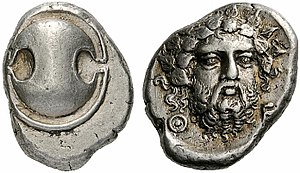Thebes, Greece - Silver stater of Thebes (405-395 BC). Obverse: Boeotian shield, reverse: Head of bearded Dionysus.