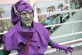 Norman Osborn - A fan dressed in Green Goblin cosplay.