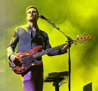 Guy Berryman - Berryman performing with Coldplay in 2011
