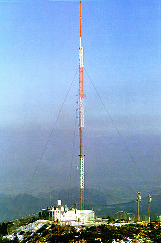 Guyed mast - A guyed radio mast. The guy lines are faintly visible.
