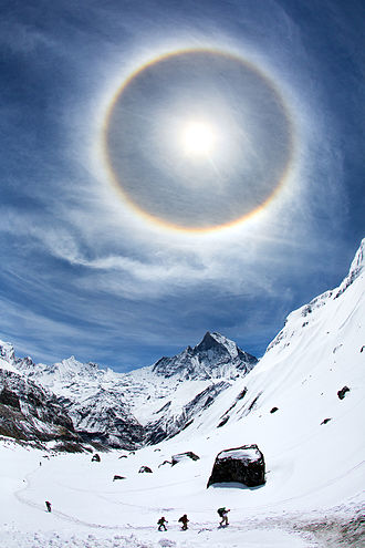 Halo (optical phenomenon) - A 22° halo around the sun as viewed in the sky over Annapurna Base Camp, Annapurna, Nepal