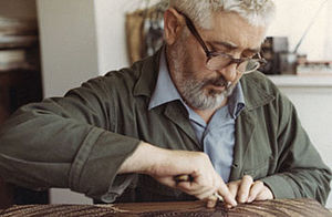 "Jacques Hnizdovsky - Jacques Hnizdovsky carving the woodblock ""Two Rams"" in his studio in New York, 1969"