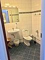 Hotel room toilet (bathroom) with hand wash sink, mirror, waste bin, toilet, etc., in Bergen, Norway 2018-03-16 A. Also wall and floor tiles.jpg