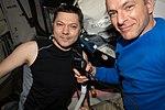 ISS-58 David Saint-Jacques cuts Oleg Kononenko's hair.jpg