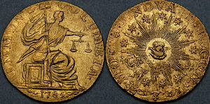 Both sides of a gold coin, depicting a seated figure and an allegorical all-seeing eye
