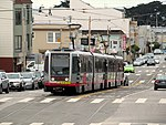Inbound train at Taraval and 30th Avenue, June 2017.JPG
