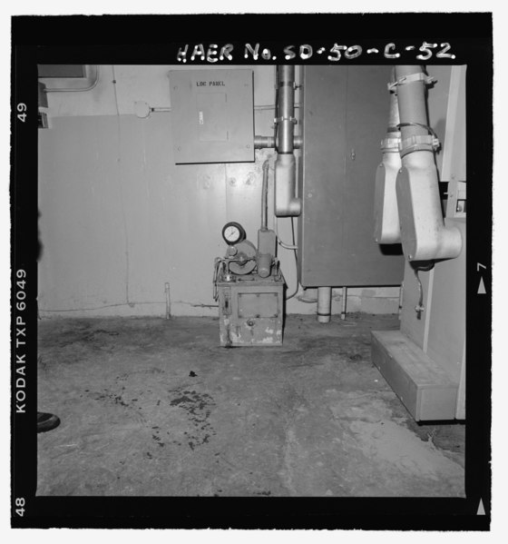 File:Interior of launch support building, hydraulic pumping unit at lower center, service disconnect at right, view towards south - Ellsworth Air Force Base, Delta Flight, Launch Facility, HAER SD-50-C-52.tif