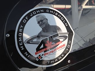 Riverside International Speedway - The decal commemorating the life of John Chisholm that was on all the cars during the 2014 IWK 250