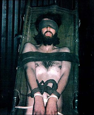 Battle of Qala-i-Jangi - Surviving prisoner John Walker Lindh photographed after being transported to Camp Rhino on December 7, 2001