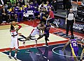 John Wall attempts free throw, Lakers bench in background.jpg