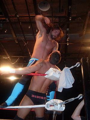 Mike DiBiase (born 1977) - DiBiase (bottom) wrestling Johnny Goodtime in 2008.