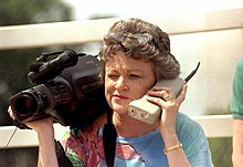 Journalist Lucy Morgan with video camera and phone (7026619371).jpg