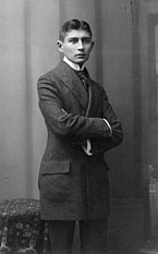 A black-and-white full-length picture of a man in a suit