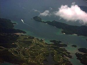Kau Sai Chau - Kau Sai Chau and its golf course. Yim Tin Tsai and the breakwater are visible at the bottom right. The island at the centre right is Sharp Island.