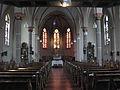Kirchenschiff mit Blick auf den Chor der katholischen Pfarrkirche Sankt Martin in Stotzheim.jpg