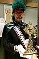Knight of Columbus holding relic of the True Cross in Utah USA on tour.jpg