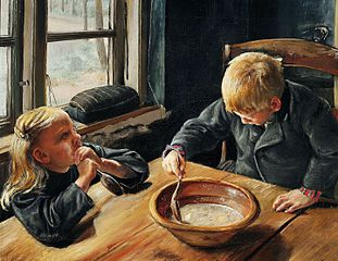 A boy and a girl eating supper