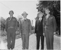 L to R, Unidentified officer, President Harry S. Truman, Secretary of State James Byrnes, and Gen. A. G. Rolling... - NARA - 198694.tif