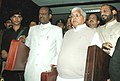 Lalu Prasad leaving for the Parliament from Rail Bhavan, along with his deputies Shri R. Velu and Shri Naranbhai Rathwa, to present the Rail Budget 2007-08, in New Delhi on February 26, 2007.jpg