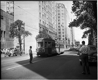 Elizabeth Street, Sydney - Last day of trams, covered in graffiti, Rural Bank tram stop, corner Martin Place and Elizabeth Street, 25 February 1961