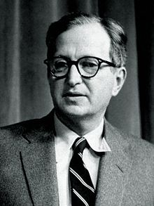 Head shot of a man in a suit wearing glasses