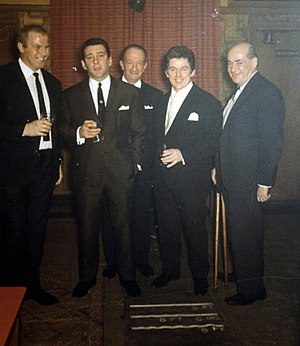 Kray twins - Photograph of London gangster Reginald Kray (second from left) taken in the months leading up to his trial in 1968. The evidence from this file and others resulted in him and his brother Ronald being sentenced to life imprisonment.
