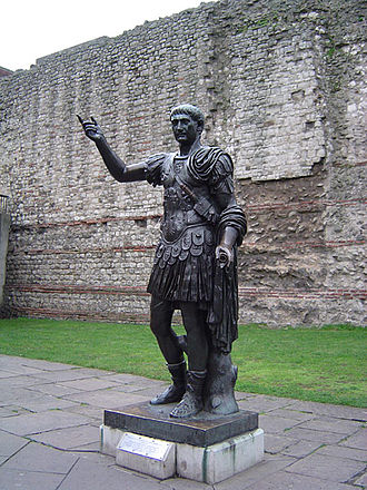 Fortifications of London - Statue of Trajan in front of a section of the Roman wall, Tower Hill