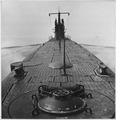 Looking forward along deck from stern of U.S. submarine off coast of New London, Connecticut - NARA - 520847.tif