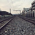 Looking to the eastern direction at Zhenyi road level crossing, Kaohsiung City, Taiwan.jpg