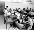 """MEMBERS OF THE PALESTINE FLYING CLUB DURING A LESSON IN AIRCRAFT MACHANICS. חברי מועדון הגלישה """"הגמל המעופף"""" במהלך שיעור מכונאות כלי טיס.D393-011.jpg"""