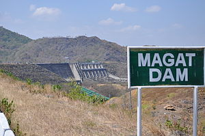 Magat Dam - The dam, with its entrance sign in the foreground