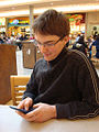 Male teen texting in mall.jpg