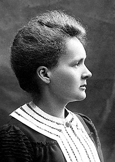 A black and white portrait of a woman in profile.