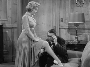 Flirting - Laurel (played by Marilyn Monroe) flirting with Dr. Fulton (played by Cary Grant) in the film Monkey Business