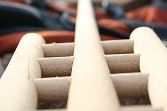 Mash rake - A closeup of the head of a traditional wooden mash rake.
