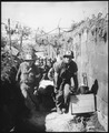 Medics remove a casualty from the battle field to an aid station in an air raid shelter, near Brest, France, formerly... - NARA - 531320.tif