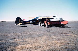 Wien Air Alaska - A Wien Alaska Airlines Cessna 170 met by a M29C weasel at Oliktok Point, Alaska (North Slope), Summer 1951