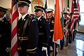 Members of the Honor Guard line up in the Grand Foyer of the White House.jpg