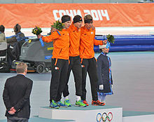 Jan Blokhuijsen, Sven Kramer and Jorrit Bergsma atop the podium with their Olympic medals