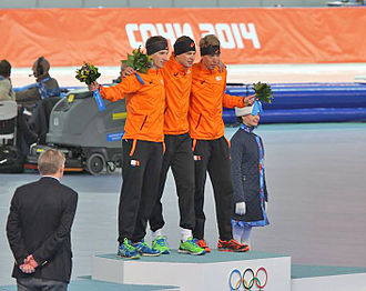 2014 Winter Olympics medal table - From left to right: Jan Blokhuijsen (silver), Sven Kramer (gold) and Jorrit Bergsma (bronze) with medals they earned in the men's 5,000metres speed skating, one of the four podium sweeps by the Netherlands.