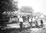Men and early biplane- Kissimmee, Florida (4138872616).jpg