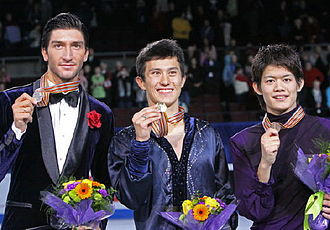2009 Four Continents Figure Skating Championships - The men's podium. From left: Evan Lysacek (2nd), Patrick Chan (1st), Takahiko Kozuka (3rd).