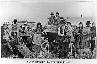Métis in the United States - A Metis family poses with their Red River carts in a field in western North Dakota.  Date of Original: 1883   Credit Line:  State Historical Society of North Dakota (A4365)