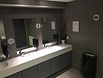 Mirrors and washbasins in public male toilet at Trondheim Airport Værnes, Norway, 2018-03-05 IMG 5499.jpg