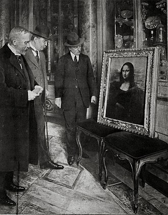 Mona Lisa - The Mona Lisa on display in the Uffizi Gallery, in Florence, 1913. Museum director Giovanni Poggi (right) inspects the painting.