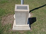 Moultrie Municipal Airport, flagpole Woodmen of the World plaque.JPG