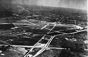 Aerial view of the Akron-Fulton airport (then NAS Akron) in the 1940s, with the Goodyear Airdock visible on the left.