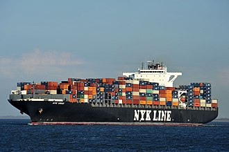 Containerization - An ocean containership close to Cuxhaven
