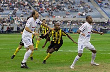 Rolín (right) vs Peñarol
