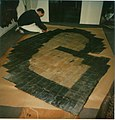 Nailing a large fur coat, Germany 1987.jpg